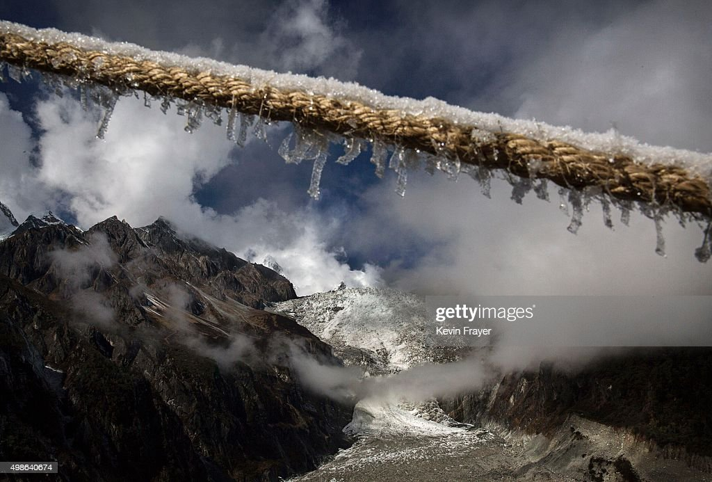 The Large Ice Fall of Glacier 1 is seen at the base of the 7,556 m (24,790 ft) Mount Gongga, known in Tibetan as Minya Konka on November 12, 2015 in Hailuogou, Garze Tibetan Autonomous Prefecture, Sichuan province, China. Hailuogou is one of China's 8,500 monsoonal glaciers and the longest of 71 glaciers on the eastern slope of Mt. Gongga. Monsoonal glaciers are found at lower altitudes and are at much higher risk to the effects of rising temperatures and climate change. Chinese scientists studying the impact on the Tibetan plateau warn the ablation rate of monsoonal glaciers is alarming. Data shows the Hailuogou basin glaciers have lost nearly 3 kilometers of mass since the 1960s and the rate is accelerating. Some researchers are concerned the glaciers could shrink at an accelerated rate beyond the present 20 meters a year and thin at a rate of more than 1 meter per year. At an upcoming conference in Paris, the governments of 196 countries will meet to set targets on reducing carbon emissions in an attempt to forge a new global agreement on climate change.