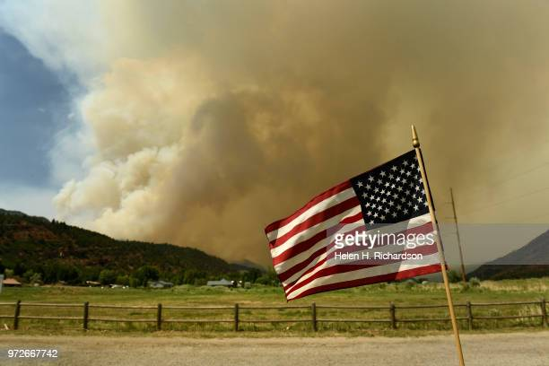 The large plume of the 416 fire begins to build in the dry afternoon in the San Juan National Forest on June 12 2018 in Hermosa Colorado The fire...