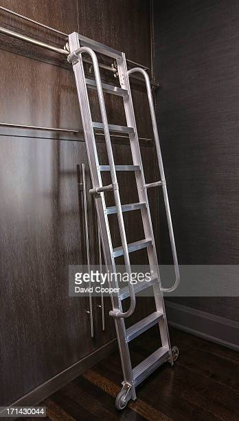 The large rolling ladder to access the upper cupboards in the kitchen and billiard room Ken and Renee Metrick owners of Elte one of the world's...