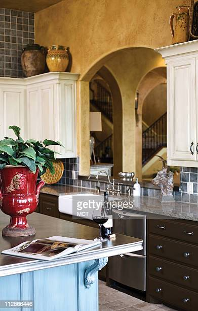 The large singlepiece pewter countertop on the kitchen's island was made to order in France and features elegant detailing around the edges Pewter...