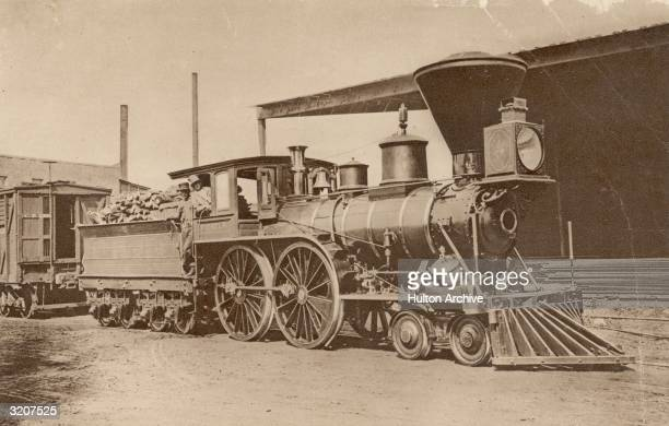 The large smoke stacked steam engine 'Pioneer' the first locomotive used in California The wood burning vehicle was nicknamed 'The Elephant' because...