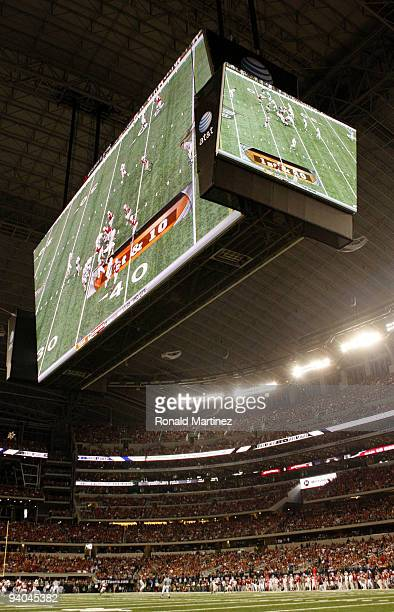 The large television screens are seen over the field during the game between the Texas Longhorns and the Nebraska Cornhuskers at Cowboys Stadium on...