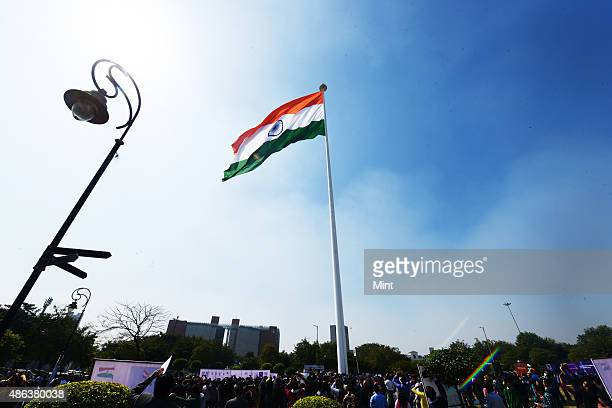 The largest National Flag measuring 60 ft X 90ft flutters atop 207 ft tall flag pole at Rajiv Chowk on March 7 2014 in New Delhi India The concept of...