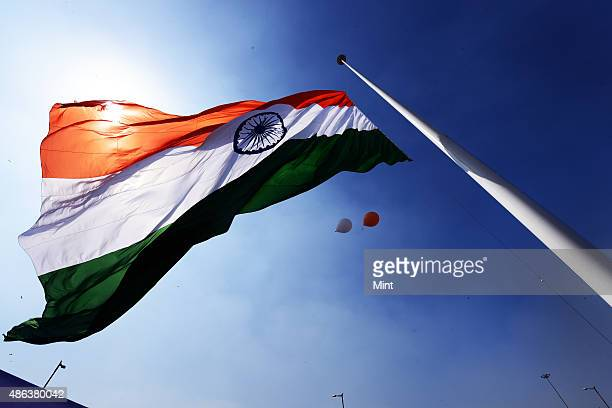 The largest National Flag measuring 60 ft X 90ft flutters atop 207 ft tall flag pole at Rajiv Chowk on March 7, 2014 in New Delhi, India. The concept...