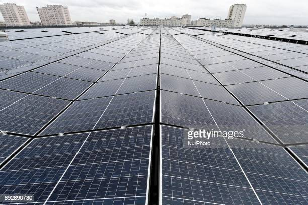 The largest photovoltaic power plant on a rooftop in the Ile de France region is pictured during its inauguration on the roof of the drinking water...