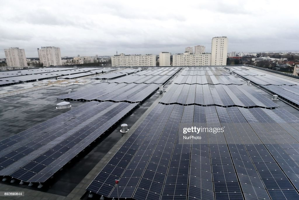 The largest photovoltaic power plant on a rooftop in the Ile de France region is pictured during its inauguration on the roof of the drinking water reservoir in L'Hay-les-Roses, south of Paris, on December 14, 2017.