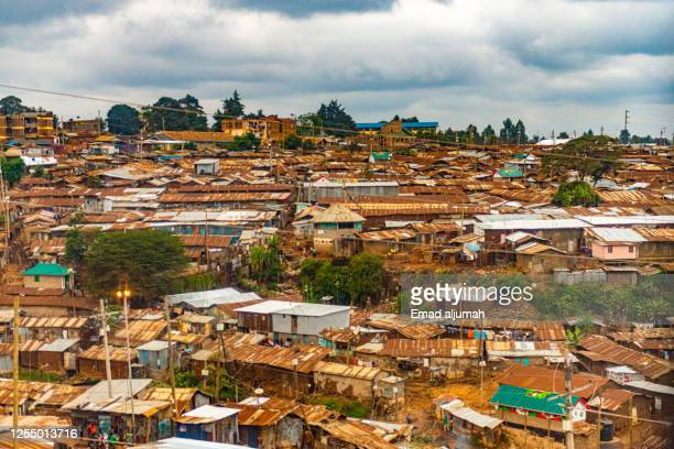 the largest urban slum in africa - nairobi stock pictures, royalty-free photos & images