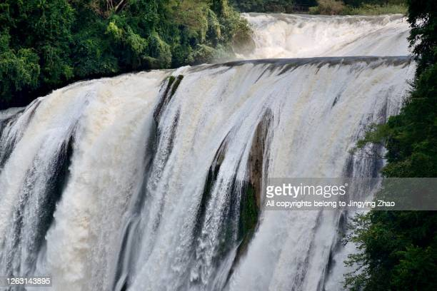 """the largest waterfall group """"huangguoshu"""" in summer time of guizhou,china - zambezi river stock pictures, royalty-free photos & images"""
