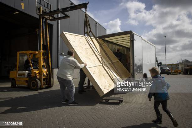 The largest work of art by British artist Banksy, White House Rat, is unloaded on April 3, 2021 in Staphorst. - The mural of 3 by 3.5 meters comes...