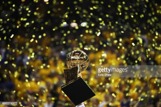 The Larry O'Brien Championship Trophy is held up by the Golden State Warriors after the defeated the Cleveland Cavaliers 129-120 in Game 5 to win the...