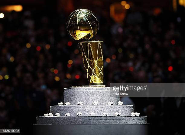 The Larry O'Brien championship trophy sits with the Cleveland Cavaliers rings before the game against the New York Knicks at Quicken Loans Arena on...
