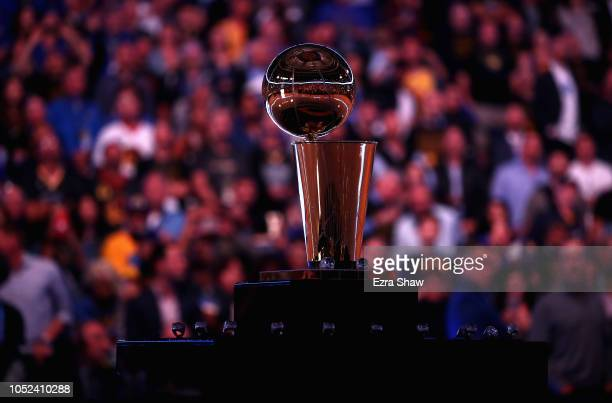 The Larry O'Brien NBA Championship Trophy sits on the court before the Golden State Warriors championship ring ceremony at ORACLE Arena on October 16...