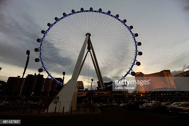 The Las Vegas High Roller at The LINQ is illuminated blue prior to going dark for Earth Hour on March 29 2014 in Las Vegas Nevada
