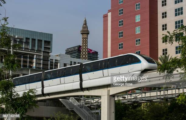 """The Las Vegas Monorail glides past The Linq and Harrah's hotels on May 31, 2017 in Las Vegas, Nevada. Tourism in America's """"Sin City"""" has, within the..."""