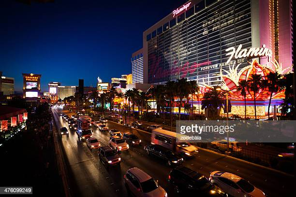 the las vegas strip and the flamingo casino at night - flamingo las vegas stock pictures, royalty-free photos & images