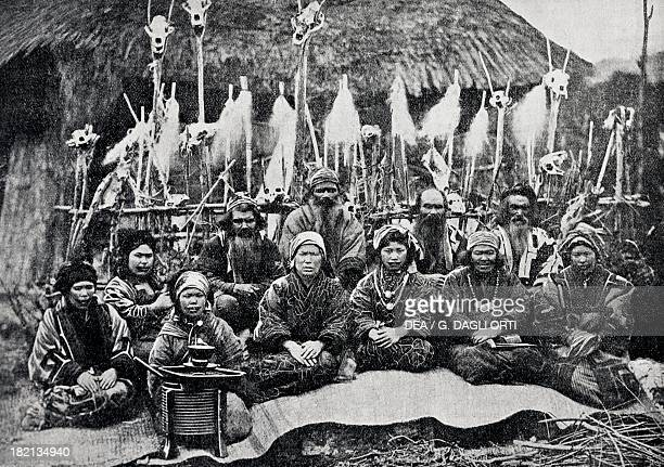 The last Ainu of the Japanese archipelago gathered in front of a hut consecrated to the divinities who protect the village photograph from Journal...