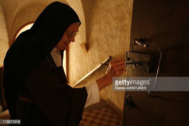 The Last Carmelite Sisters In Pamiers, France On July 29, 2008 - Saint Therese of the Child Jesus , prioress of the Caramel pray behind the gates of...