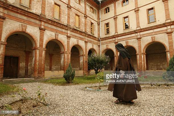 The Last Carmelite Sisters In Pamiers, France On July 29, 2008 - The cloister of the Carmel of Pamiers and its garden, in the center located Calvary...