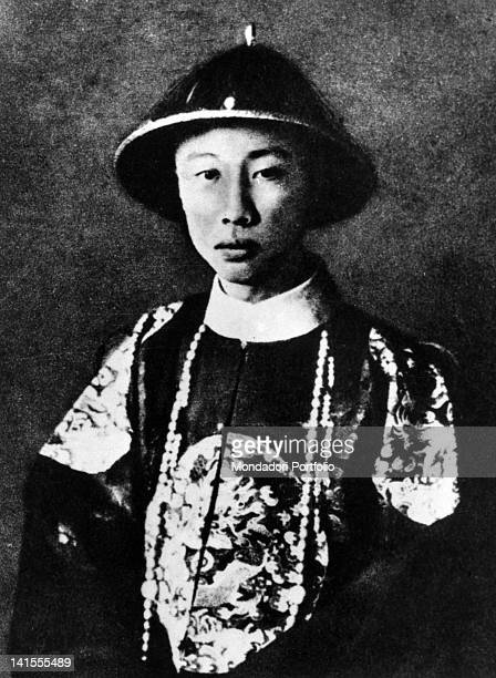 The last emperor of China Pu Yi posing with traditional clothes 1920s
