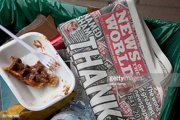 The last ever copy of tabliod newspaper News of The World in the cart of a street cleaner as someone throws in more rubbish Sunday 10th July 2011 saw...