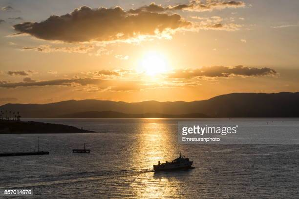 the last ferry from cesme to chios island before sunset. - emreturanphoto stock pictures, royalty-free photos & images
