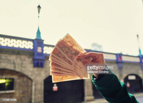 the last few pounds, what to do with it? tower bridge over the thames river, london, uk. - british currency stock pictures, royalty-free photos & images