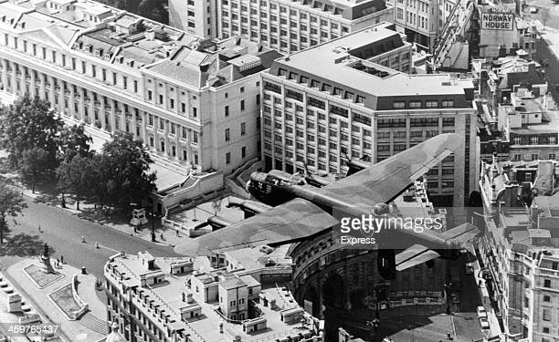 The last flying Lancaster bomber roars over Admiralty Arch home of ancient Navy tradition to mark the Royal Tournament parade in London July 121976