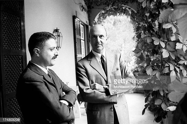 The last King of Italy Umberto II smiling in company of Italian journalist Giorgio Torelli in the porch of the villa where he spends his exile....