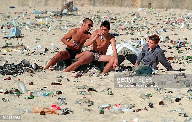 The last of the hard drinkers at a littered Bondi Beach in Sydney after Christmas Day celebrations 26 December 1995 SMH Picture by DEAN SEWELL
