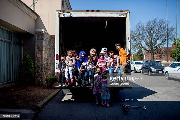 TORONTO ON MAY The last of the kids staying at the hotel pose for a photo after loading the moving truck Six months after its inception the...