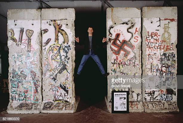the last peace of the berlin wall in potsdam platz - nazi swastika stock pictures, royalty-free photos & images