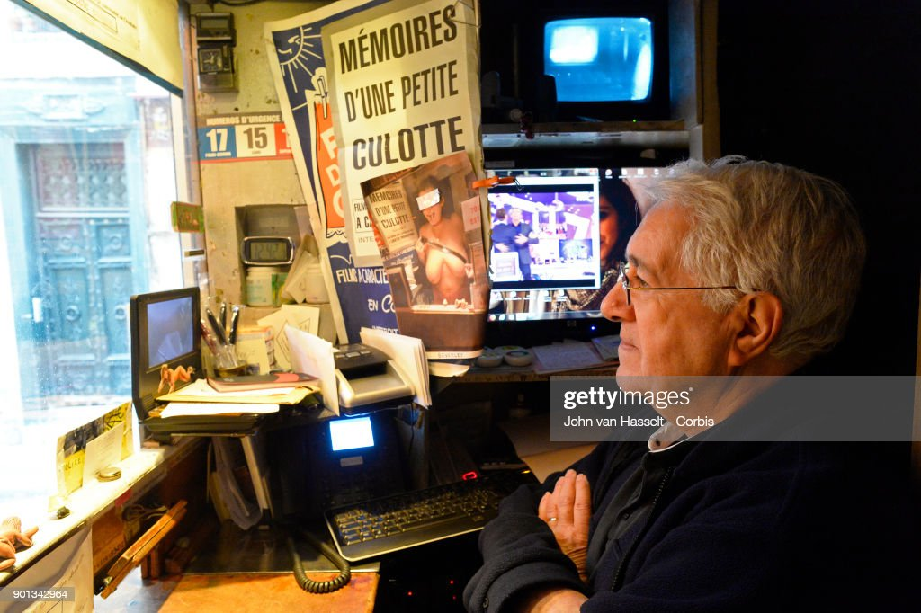 The last porn cinema, le Beverley, in Paris is closing its doors at the end of January. The proprietor Maurice Laroche aged 74 who also sells tickets in the box office has been running the business since 1982. Due to porn on the internet and the dwindling numbers of customers competition is too great. Online erotica has taken over the cinema circuit. Today he sells 600 tickets a week whereas 20 years ago it was more than 1,500. In the early 1980s there were 20 porn cinemas between la Place de la République and l'Opera. Now on January 03, 2018 in Paris, France Maurice Laroche who is retiring must shut down by the end of the month. In the projection room celluloid film survives, screened from a 50 year old film projector to the delight of the connaisseurs of vintage porn where most of the regular clients are more than 60 years old today. Maurice Laroche waits for customers in the box office. (Photo by John van Hasselt/Corbis via Getty Images01