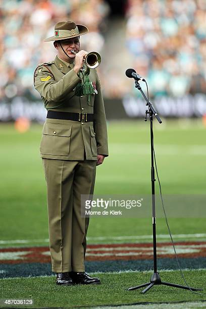 The last post is played for ANZAC day during the round six AFL match between Port Adelaide Power and the Geelong Cats at Adelaide Oval on April 27...