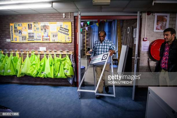 The last preparations are made at a polling station at a school in Rotterdam on March 14 a day before legislative elections / AFP PHOTO / ANP / Robin...