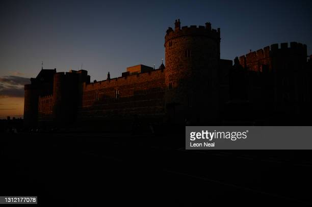 The last rays of light hit the battlements of Windsor Castle, as tributes continue to be made to Prince Philip, the Duke Of Edinburgh who died at age...
