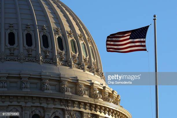 The last rays of sunlight fall on the dome of the US Capitol January 30 2018 in Washington DC President Donald Trump will deliver his first State of...