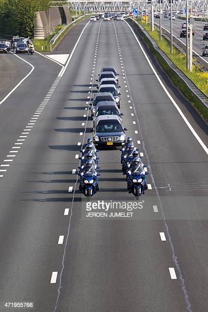 The last remains of Dutch victims of the MH17 plane crash are transported nearby Waardenburg from Eindhoven Airport in Eindhoven to the Korporaal van...