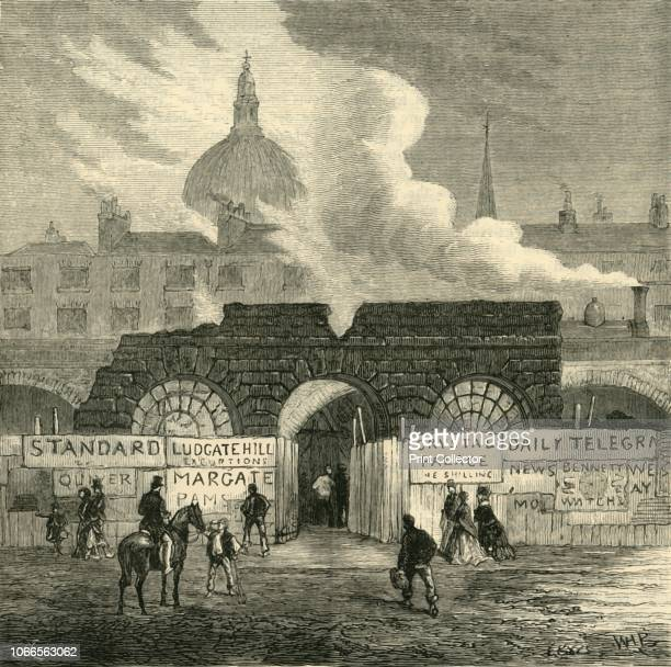 The Last Remains of the Fleet Prison', circa 1872. Hoardings advertising the Crystal Palace outside the ruins of the prison, with a steam train and...