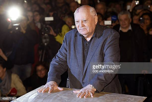 The last ruling President of the Soviet Union Mikhail Gorbachev leaves his handprints in plaster cast bolted onto an original Wall piece from former...