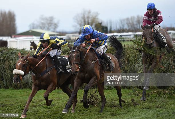 The Last Samuri Vics Canvas and Rule the World by David Mullins jump the final fence during the Grand National at Aintree Racecourse in Liverpool...