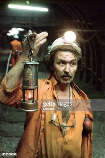The last shift at Cotgrave Colliery one of the last miners underground holds a Davy lamp Circa 1992