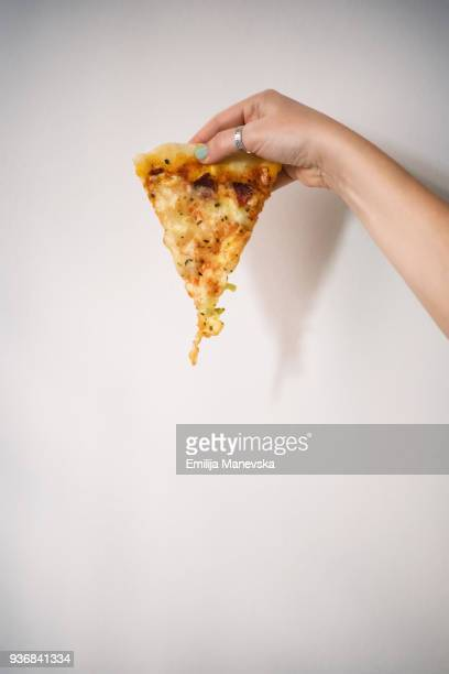 the last slice of homemade pizza - cheese pizza stock photos and pictures