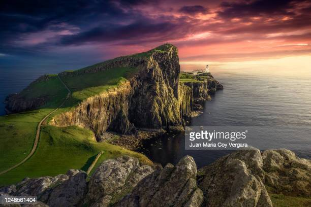 the last sunbeam at neist point lighthouse - isle of skye (glendale, scotland) - mountain stock pictures, royalty-free photos & images