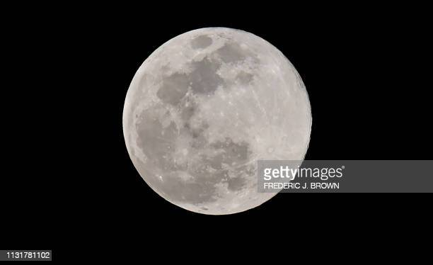 The last Supermoon of 2019 known as the 'super worm equinox moon' is seen above Los Angeles on March 20 coinciding with the spring equinox The last...