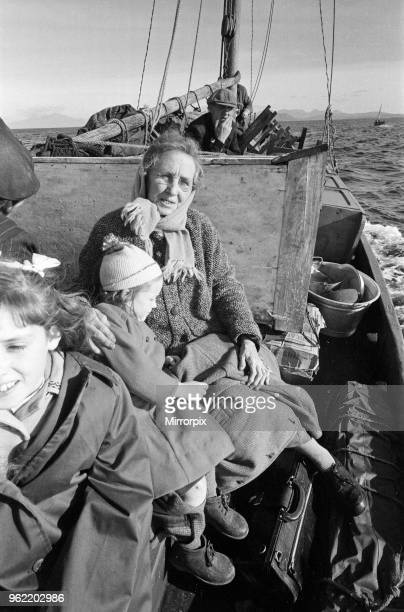 The last twenty three residents of Inishark Island off the coast of County Galway Ireland are pictured evacuating the Island The residents have lost...