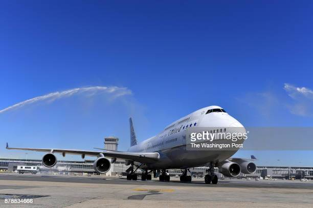 The last United Airlines 747 is greeted by water cannons after it makes its final landing at Dulles International Airport October 19 2017 in Dulles...