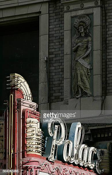 The late afternoon sun highlights the marquee of the Palace Theatre one of the grand old movie houses in downtown Los Angeles' historic Broadway...