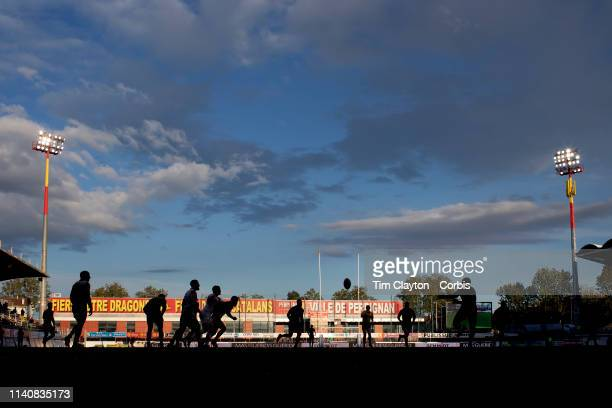 April 6: The late afternoon sunshine catches the distant advertising hoardings as the teams play in the shadows during the Catalans Dragons V St....