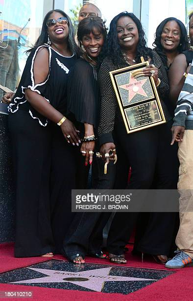 The late Barry White's wife Glodean White and family members pose following the unveiling of her husband's posthumous star along the Hollywood Walk...
