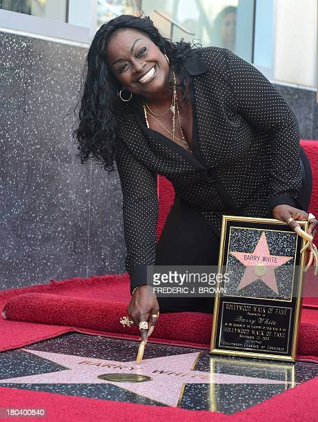 The late Barry White's wife Glodean White points to his star following the unveiling of her husband's posthumous star along the Hollywood Walk of...